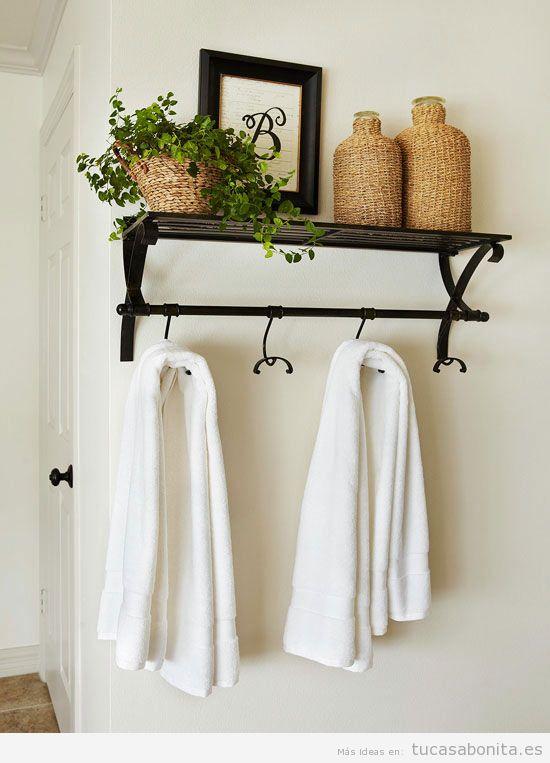 Ideas para decorar cuartos de ba o y lavabos peque os tu for Colgador toallas para bano