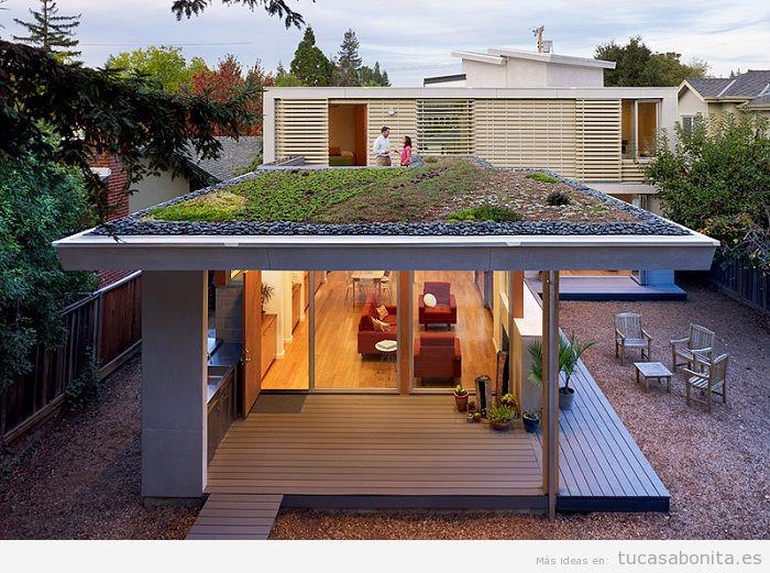 Casas hechas con contenedores marítimos y tejados jardín 8