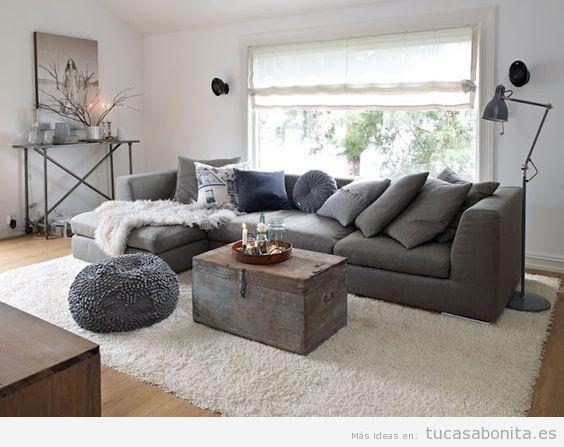 Bonita alfombra beige para sofá gris