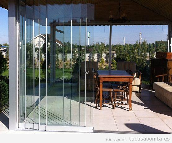 Cortinas de cristal para cerrar terrazas porches y ticos for Cortinas para terrazas exteriores