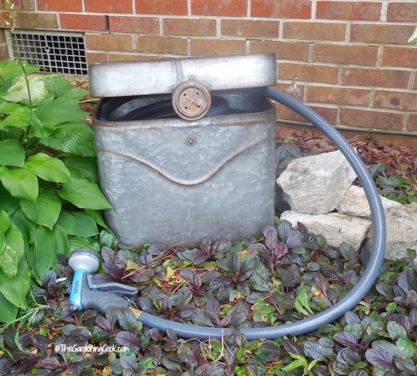 Guardar y esconder manguera del jardín 5