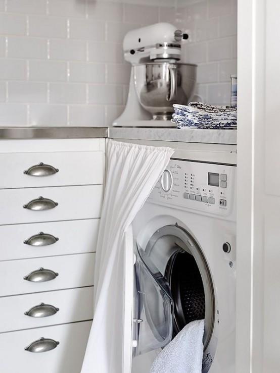 Ocultar lavadora con armario en la cocina en la cocina